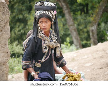Phongsaly, Laos - november 2, 2019: portrait young Akha woman wearing traditional clothings belonging to minority ethnic group living in hilltribe villages around Phongsaly, North Laos.