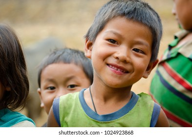 PHONGSALY PROVINCE,  LAOS - AUGUST 21, 2017:  Child from the Akha tribe are posing for a photo in mountains of North of Laos.