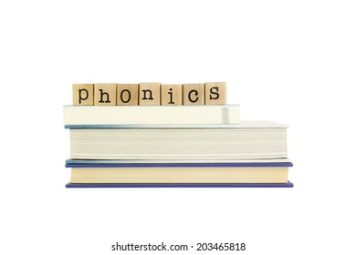 phonics word on wood stamps stack on books,  language and reading concepts