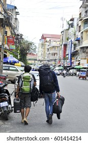 PHONM PENH, CAMBODIA - JUNE 13 2013: Unidentified traveller with their bagpack in Phnom Penh, Cambodia.