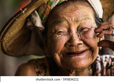 PHOP PHRA, TAK, THAILAND - MARCH 08, 2017 : Unidentified Asian woman very old aged is looking steadily with narrow gaze and delightful face at Phop Phra, Tak, Thailand.