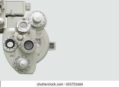 Phoropter, ophthalmic testing device machine on white background.half of phoropter used for background