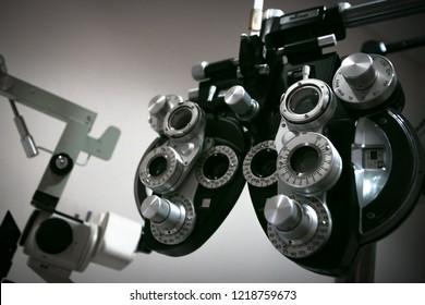 Phoropter at optometrist office, to determine prescription for prescription contact lenses or eyeglasses.