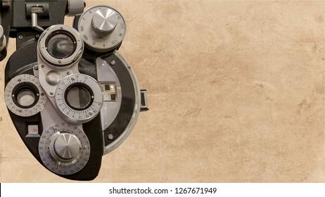 A phoropter set against a parchment background