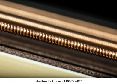 Phosphor bronze string of electroacoustic guitar, extreme macro photography. Guitar wallpaper