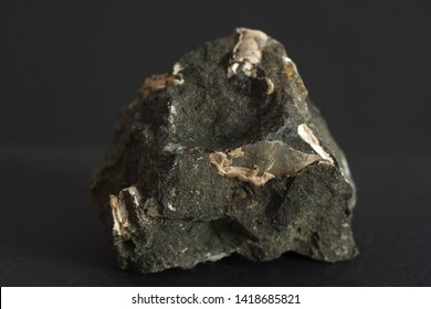 Phosphorite also phosphate rock mineral, a non-detrital sedimentary rock which contains high amounts of phosphate minerals isolate on black background
