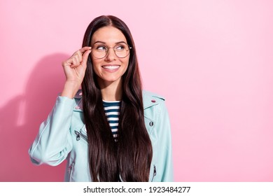Phot of pretty beautiful curious young woman hold glasses look empty space isolated on pastel pink color background