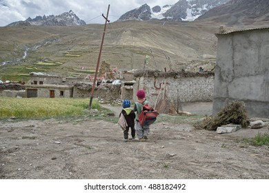 Photaksar. India,  August 26-2016 Unidentified children returning from school Photaksar village Zanskar, Ladakh, Indian Himalayas, Jammu and Kashmir, northern India, India, Asia