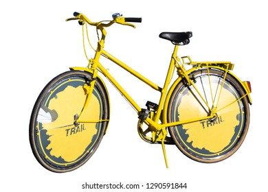 Photgraph of a positive old yellow sports bicycle on a white background with space for advertisement on wheels