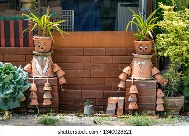 PHOTHARAM, THAILAND, JUN 02 2018, Decorative funny figures of flower pots in the garden.