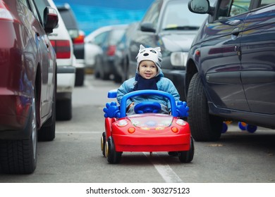 photi of cute little boy on supermarket parking