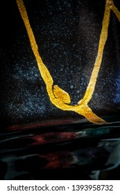 Photo #1 of a black vase with gold lines that I did using the art form of kintsugi with urushi lacquer and gold powder.