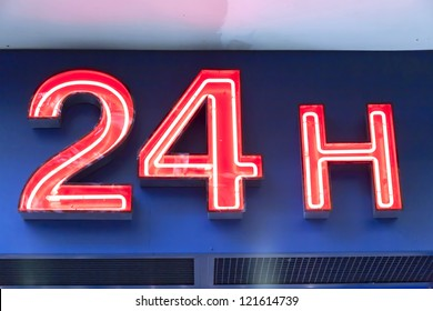 A photo of a 24h neon sign