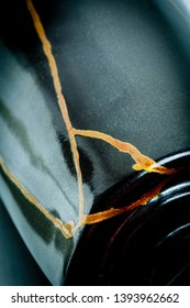 Photo #5 of a black vase with gold lines that I did using the art form of kintsugi with urushi lacquer and gold powder.
