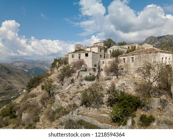 Photo of abandoned Albanian buildings in the village of Upper Qeparo, Albania