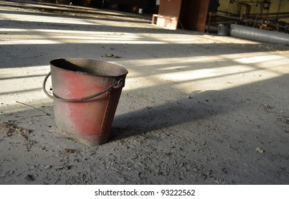 A photo of an abandoned fire bucket