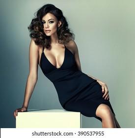 Photo of adorable brunette girl wearing black dress