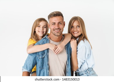 Photo of adorable caucasian family woman and man with little girl smiling and posing together at camera isolated over white background