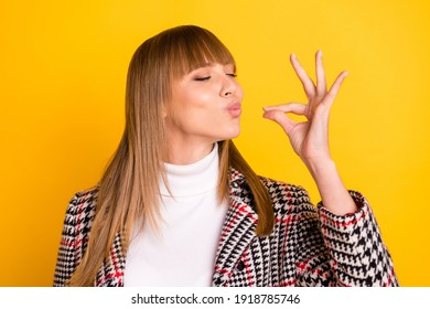 Photo of adorable person closed eyes arm fingers show gourmet gesture isolated on yellow color background