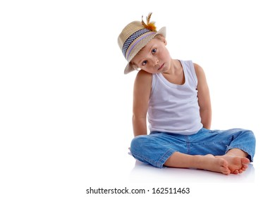 Photo of adorable young boy looking at camera siting in studio.