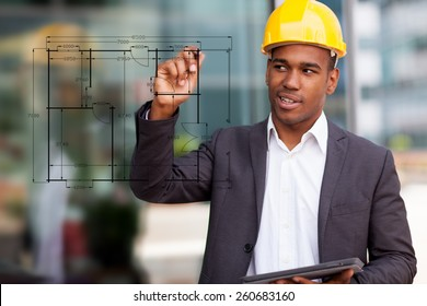 Photo of African construction engineer drawing with a digital pen
