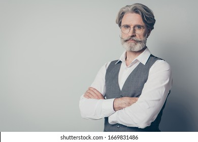 Photo of aged attractive macho business man boss standing not smiling serious look arms crossed wear specs office white shirt waistcoat isolated grey color background