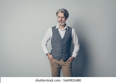 Photo of aged macho business man strict boss serious look empty space listen colleagues wear specs office white shirt waistcoat trousers isolated on grey color background