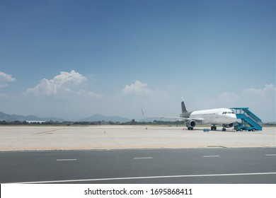 Photo with airplane landed on empty airfield without people. Most aircraft fleet landed due covid-19 global pandemy quarantine