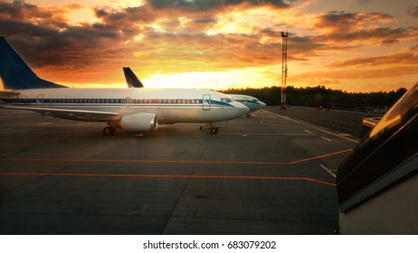 photo of Airplane at sunset - back lit