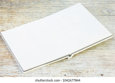 Photo album is decorated in a beautiful photobook and Photographic Equipment. on a wooden table.