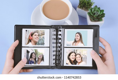 Photo album with empty instant photos on light blue background. Travel concept