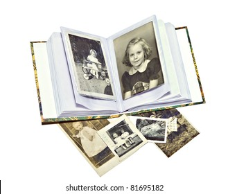 A photo album with old pictures of family members.