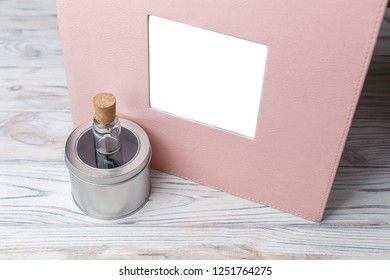 photo album on a wooden background photobook and flash drive with a box photobook in a leather cover