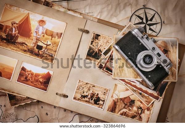 古い地図の背景に旅行やビンテージの古いカメラの写真付きフォトアルバム