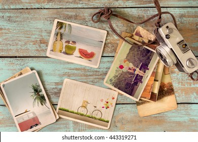 Photo album remembrance and nostalgia of journey honeymoon trip in summer on wood table. instant photo of retro camera - vintage and retro style