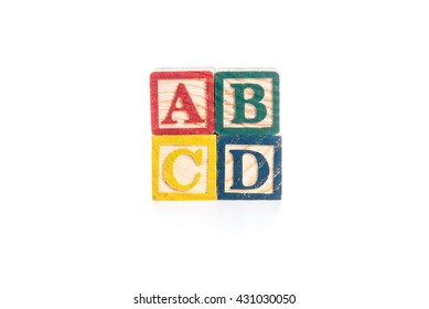 photo of a alphabet blocks spelling ABCD isolate on white background
