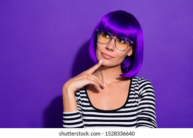 Photo of amazing lady touch chin finger look up empty space wear bright wig striped pullover isolated purple background