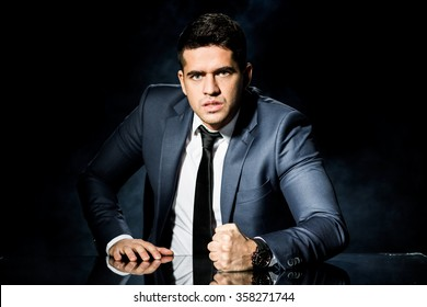 Photo of angry boss slamming fist on table