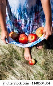 Photo of apples in the blue dress vertical