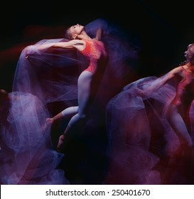 photo as art - a sensual and emotional dance of beautiful ballerina through the veil on a dark background