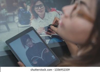 Photo of asia  women are using  electronic tools,focus on hand