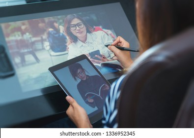 Photo of asia women are using electronic tools,focus button on hand