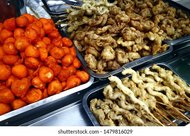 Photo of assorted fried street food at a street food cart