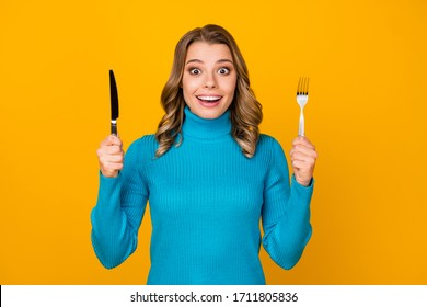 Photo of attractive charming wavy lady hold metal knife fork ready to start tasty food dinner meal good appetite wear blue turtleneck isolated bright yellow color background