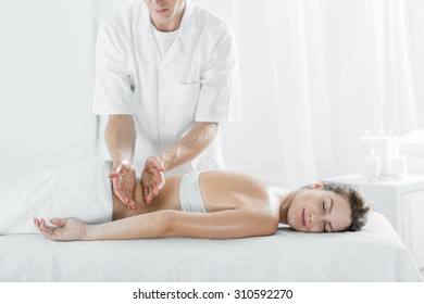 Photo of attractive female pampering her body in day spa