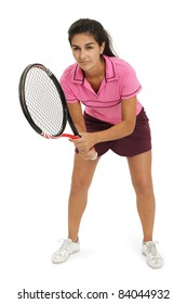 Photo of a attractive female tennis player waiting for the serve.  Full body shot with slight shadow around shoes.