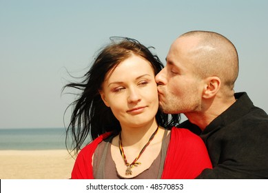 Photo of an attractive hot couple enjoying at the beach