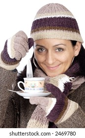 photo of an attractive lady sheltered for the winter drinking a tea cup