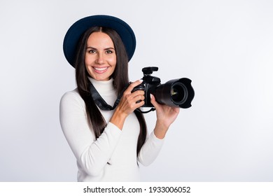 Photo of attractive positive photographer girl hold hands camera studio wear hat smile isolated on grey color background