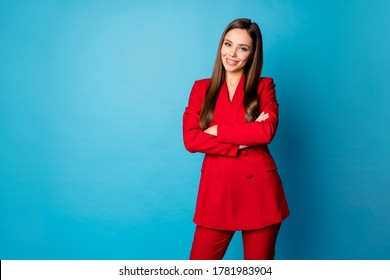 Photo of attractive self-confident business lady hold arms crossed toothy smiling bossy person wear red luxury office blazer trousers suit isolated blue color background